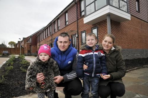 Family of four in front of new house in West Avenue in Crewe